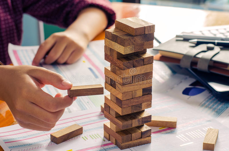 Business risks in the business. Requires planning Meditation must be careful in deciding to reduce the risk in the business. As the game drew to a wooden block stock images