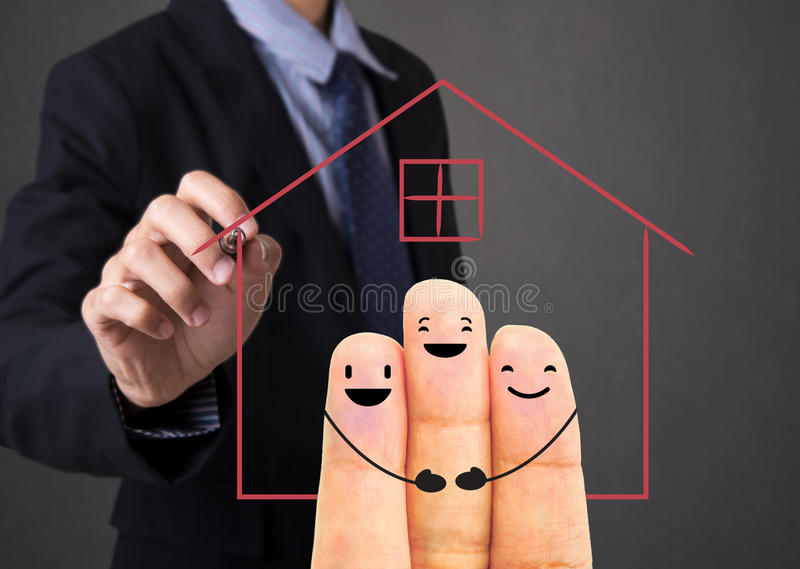 Business salesman agent hand writing home with finger family royalty free stock photos