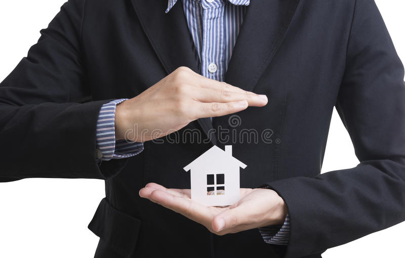 Business salesman hand holding home insurance. stock photo