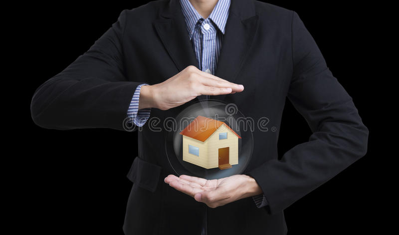 Business salesman hand holding protection home. Business salesman hand holding protection home concept home insurance stock image