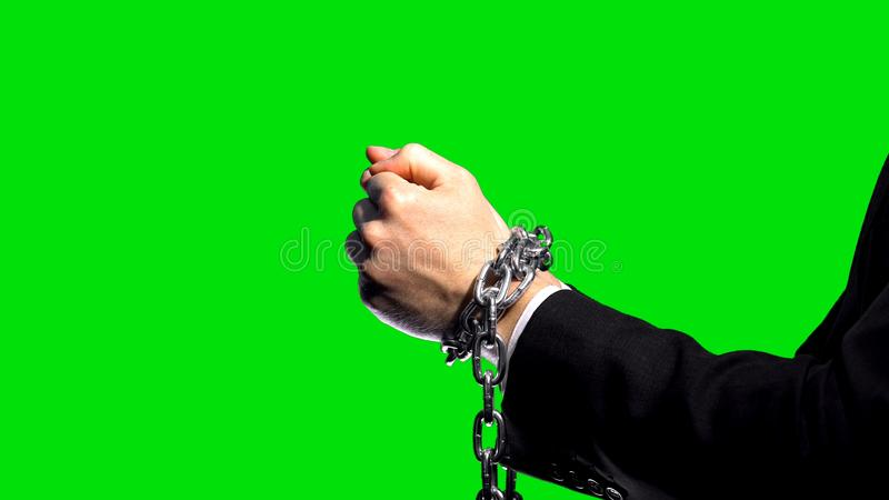 Business sanctions, chained arms on green screen background, economic conflict. Stock photo stock photos