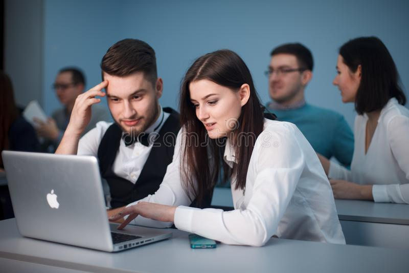 2016.01.17 Business school training in the Samara State University. Handsome couple of students use Laptop while stock images