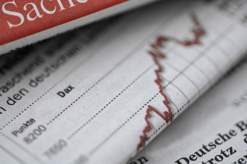 Business section of newspaper stock photos