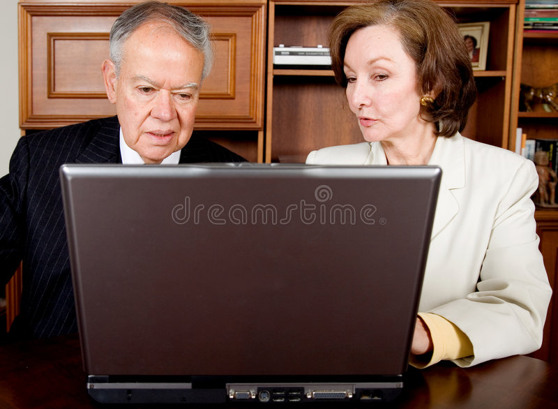 Download Business Senior Couple On A Laptop Stock Photo - Image of female, office: 1680290