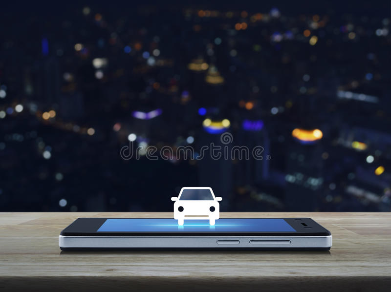Business service car concept. Car flat icon on modern smart phone screen on wooden table over blur colorful night light city tower, Business service car concept stock images