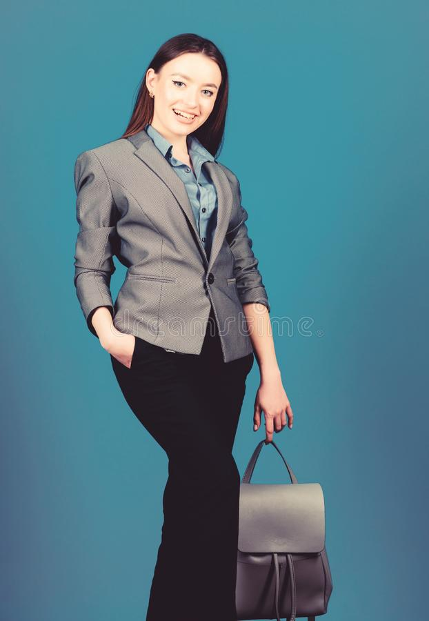 Business. Shool girl with knapsack. stylish woman in jacket with leather backpack. girl student in formal clothes stock photography