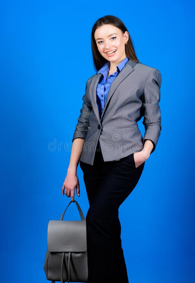 Business. Shool girl with knapsack. stylish woman in jacket with leather backpack. girl student in formal clothes. Female bag fashion. student life. Smart royalty free stock photo