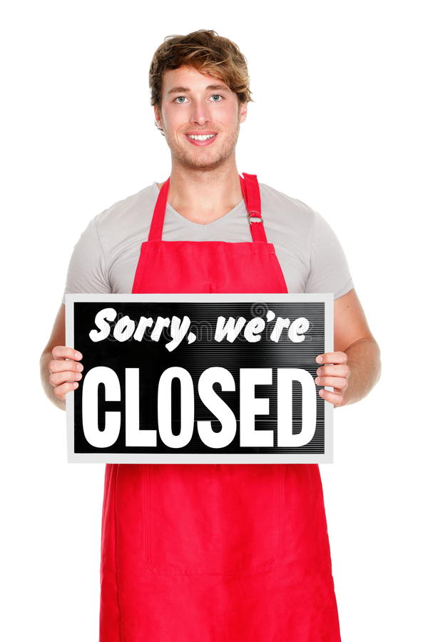 Business shop owner showing closed sign stock photos