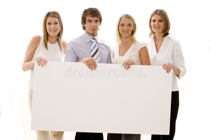 Business Sign. Four business people holding a large blank sign royalty free stock image