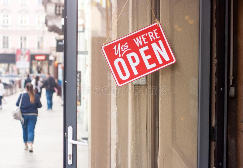 Business sign that says Yes, We are Open hanging on the door royalty free stock photo