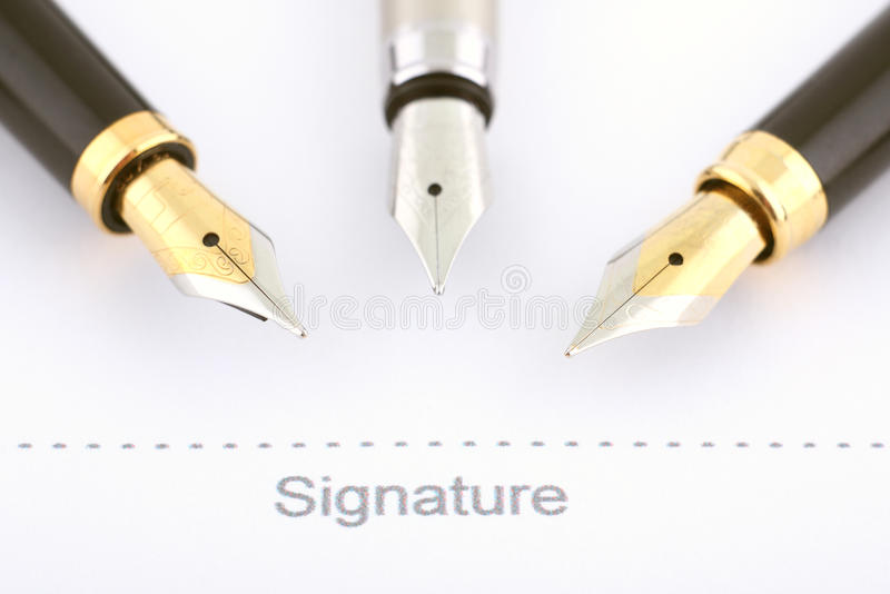 Business signature. Three fountain pens royalty free stock images