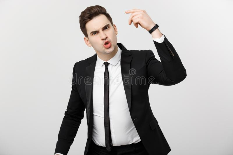 Business situation Concept: Frustrated business person angrily yelling at camera. Business situation Concept: Frustrated business person angrily yelling at royalty free stock image