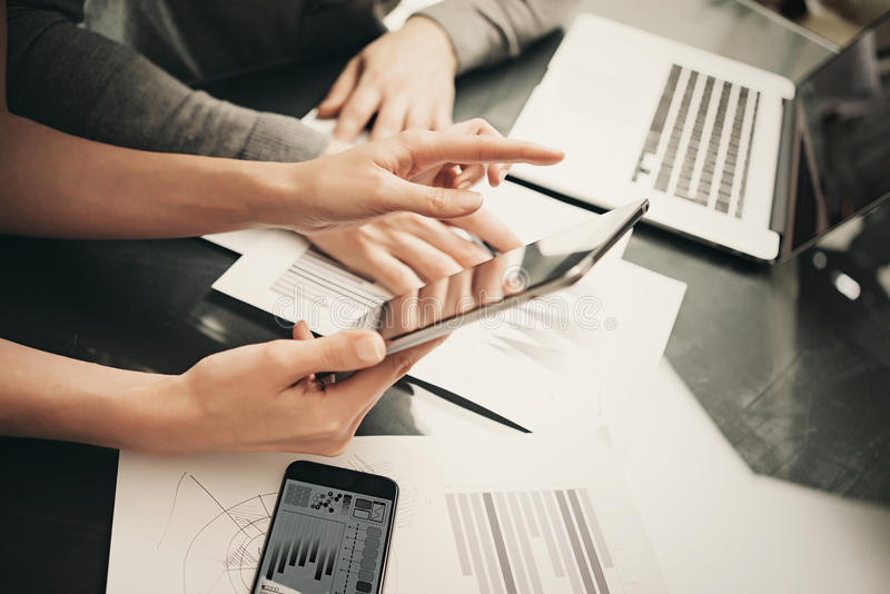 Business situation,meeting of financial analysts.Photo woman showing marketing reports tablet.Modern smartphone and royalty free stock photos