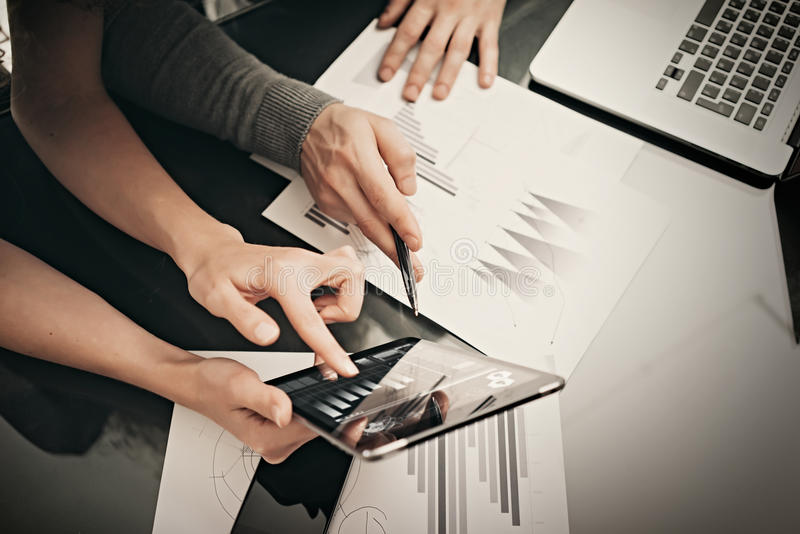 Business situation,meeting of financial managers.Photo woman showing marketing reports tablet.Modern laptop on table royalty free stock photo