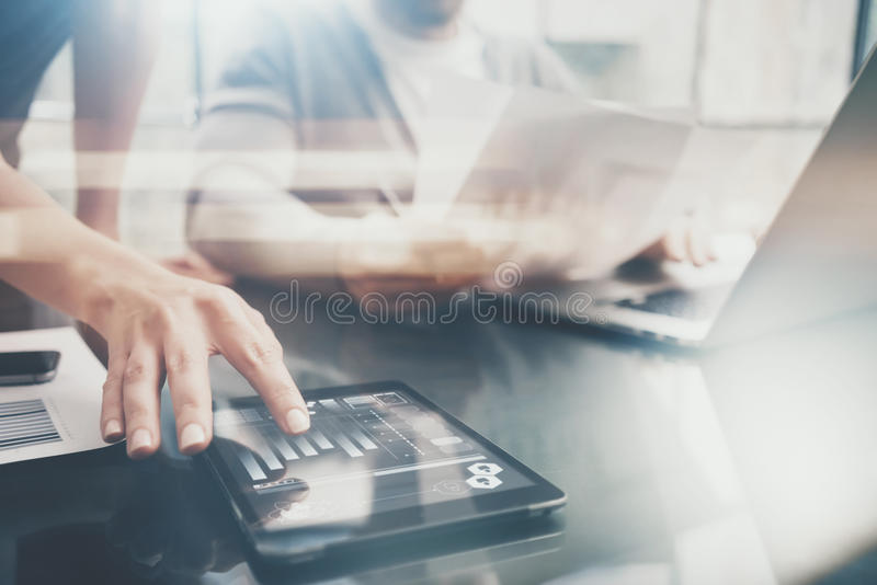 Business situation.Meeting of investment managers.Photo female showing document.Man holding report, using laptop.Working. Process modern office,discussion royalty free stock images