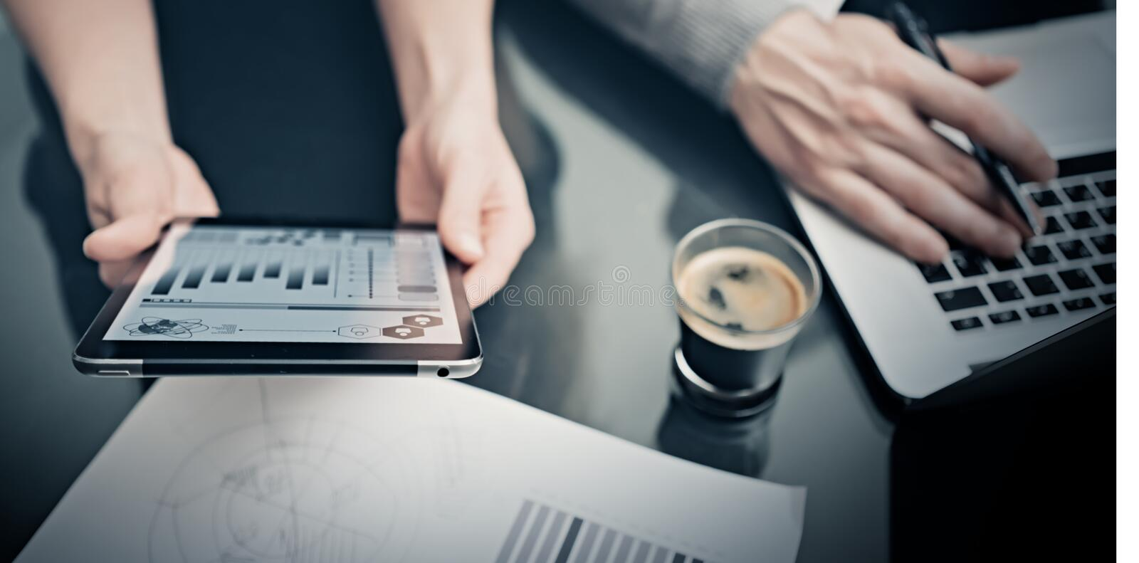 Business situation,meeting of marketing managers.Photo woman showing market reports modern tablet. Man using notebook. Business situation,meeting of marketing royalty free stock images