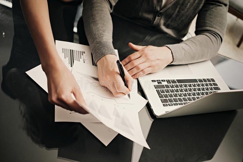 Business situation, signs documents. Account manager working modern office with new business project. Using laptop. Discussion startup, colsultation colleague royalty free stock images