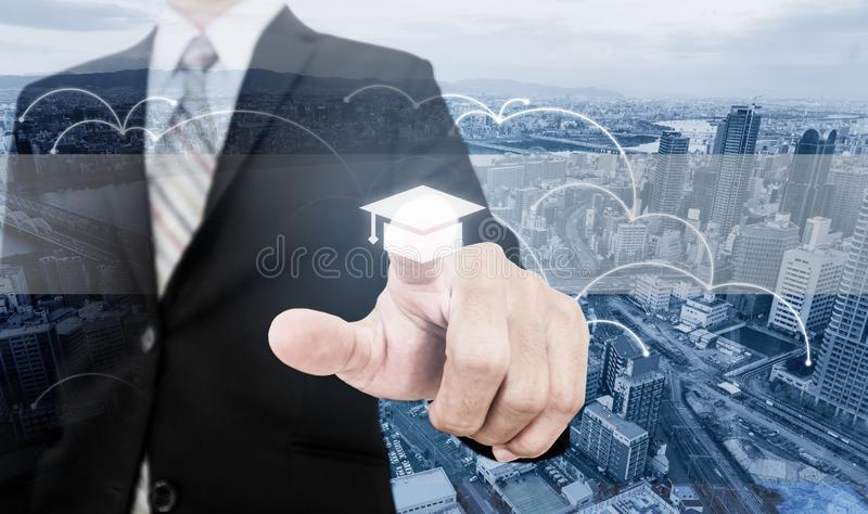 Business skills improvement and learning, online education and e-learning. Businessman touching on education screen stock photo