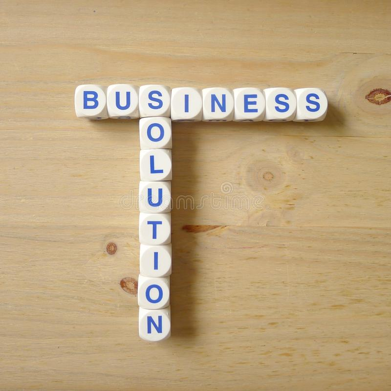 Business solution. Letters cube wordings on wood background stock image