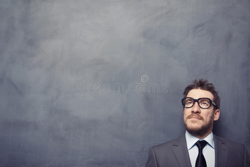 Business speech. Businessman at front of the blackboard stock photography