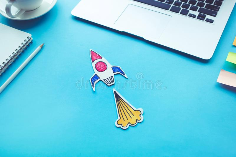 Business start up concept with rocket on desk table. stock image