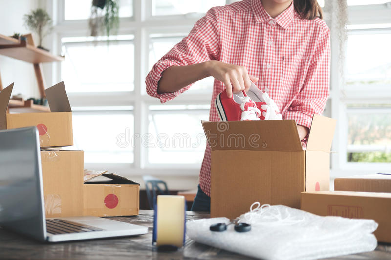 Young startup entrepreneur small business owner working at home, packaging and delivery situation. Business Start up SME concept. Young startup entrepreneur royalty free stock image