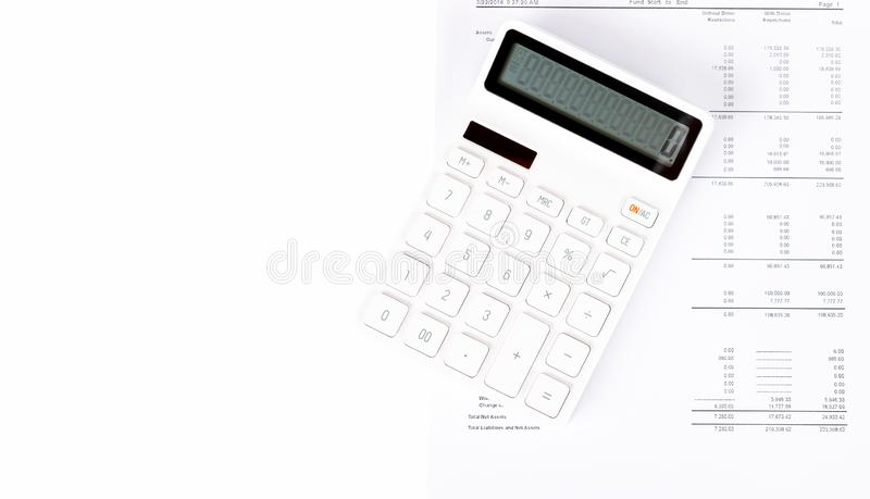 Business startup analysis summary report and using a calculator to calculate the numbers. royalty free stock photo