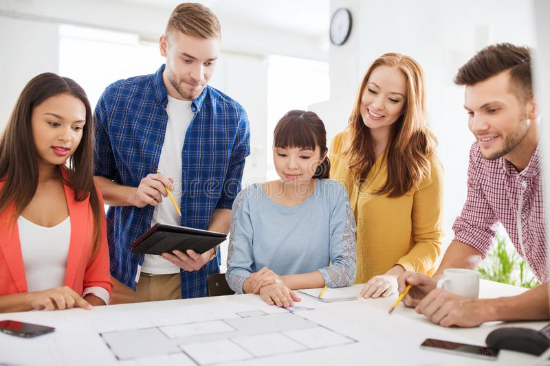 Creative team with blueprint working at office stock image image download creative team with blueprint working at office stock image image of asian indoors malvernweather Gallery