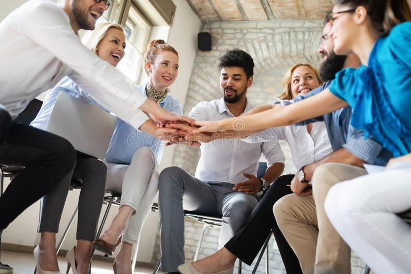 Business, startup, gesture, people and teamwork concept - happy creative team in office royalty free stock photo