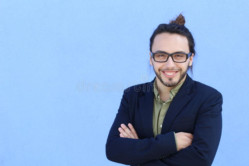Business, startup, inspiration and people concept - happy Mediterranean man with beard and hair bun. Copy space on the left stock image