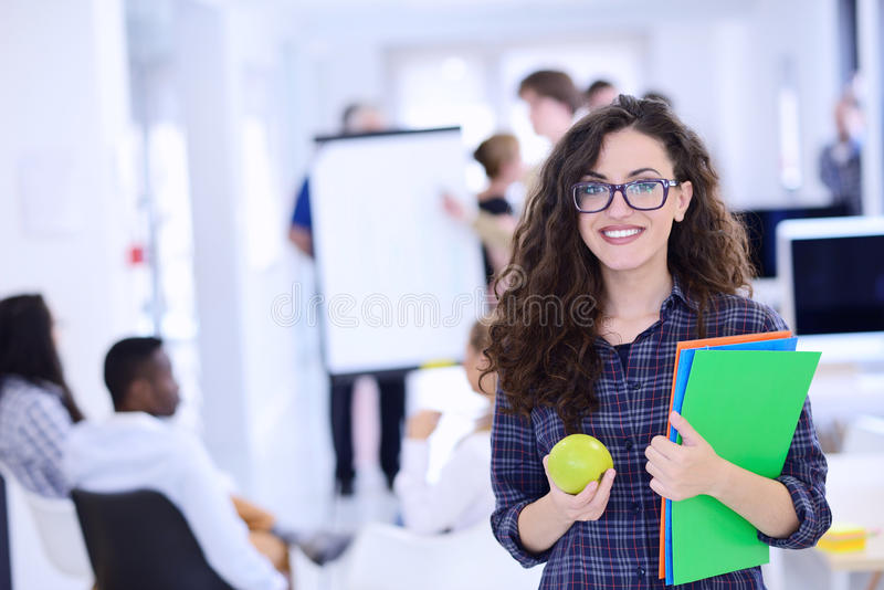 Business, startup and people concept - happy creative team with computer and folder in office.  stock images