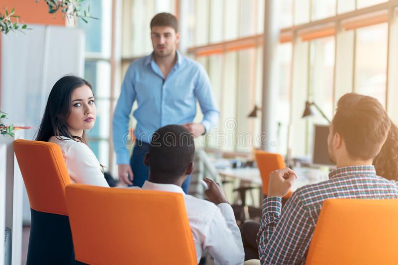 Business, startup, presentation, strategy and people concept - man making presentation to creative team at office. Business, startup, presentation, strategy and royalty free stock photos