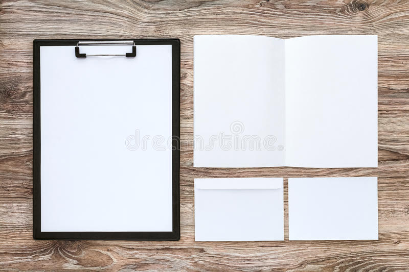 Business stationery mock-up. Template set of corporate identity on wooden desk. Business stationery mock-up with brochure, envelope, card, etc. Top view stock image