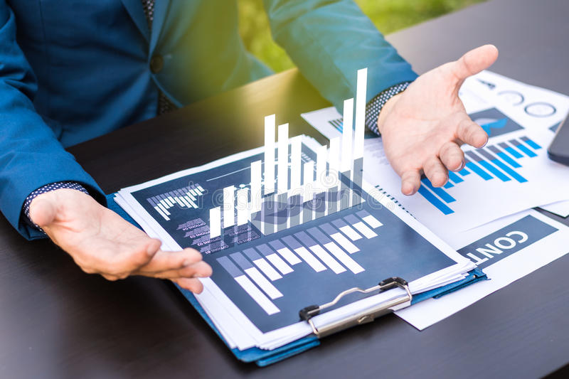 business statistics success concept : businessman analytics financial chart and graph stock photo