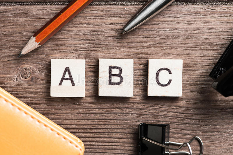 Business still life concept. Workspace desk with keyboard office working stuff and wooden elements with the letters collected in the word ABC royalty free stock photography
