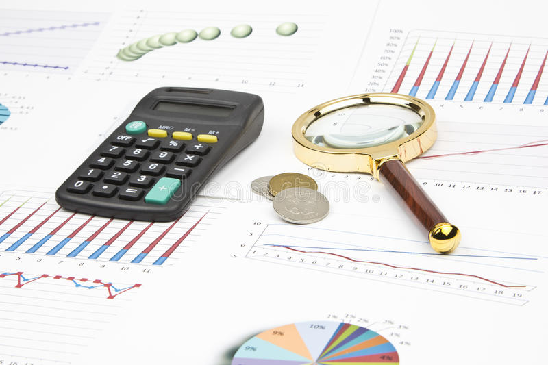 Business still-life. Of magnifier, charts, calculator, graphs, coins stock image