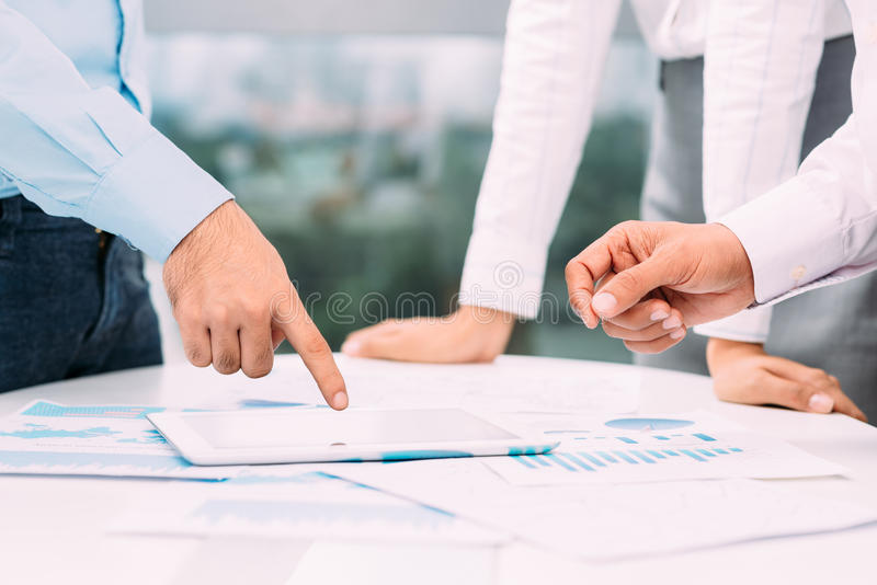 Business strategy. Colleagues discussing business strategy together royalty free stock image