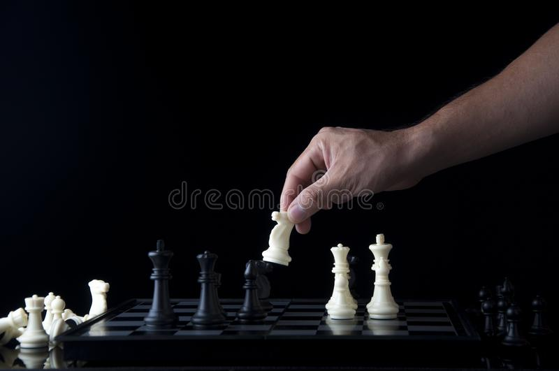 Business strategy concept on black background. Start up business planning Strategy idea with chess game. 5. Business strategy concept. Chess strategy idea on stock photo