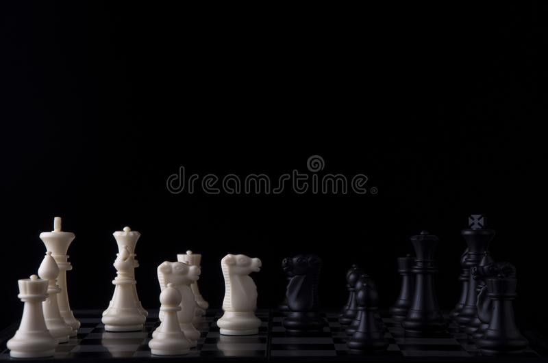 Business strategy concept on black background. Start up business planning Strategy idea with chess game. 3. Business strategy concept. Chess strategy idea on stock photography