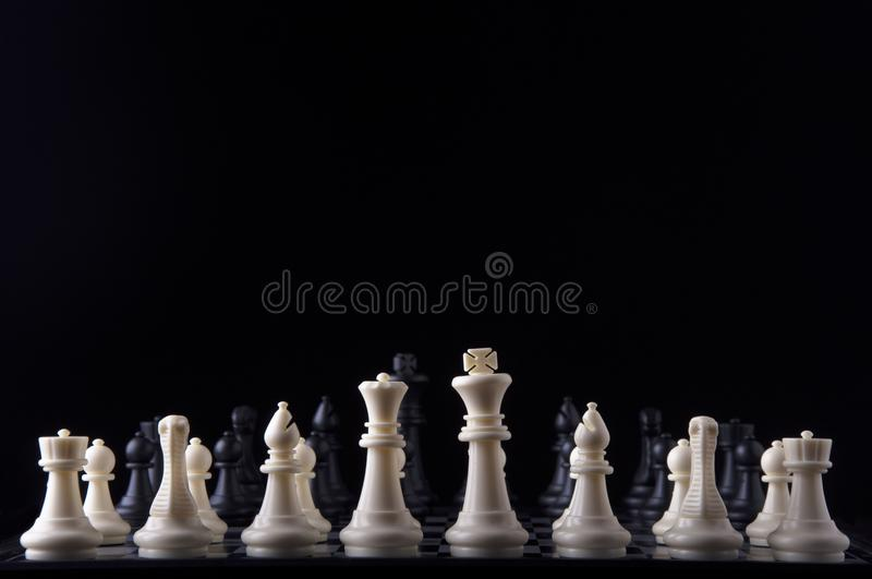 Business strategy concept on black background. Start up business planning Strategy idea with chess game. 1. Business strategy concept. Chess strategy idea on stock image