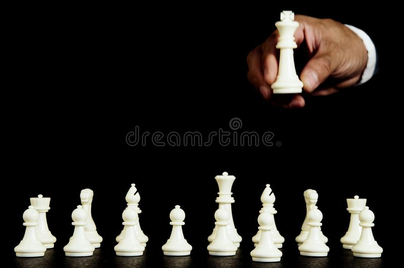 Business strategy concept on black background. Start up business planning Strategy idea with chess game. 26. Business strategy concept. Chess strategy idea on royalty free stock images