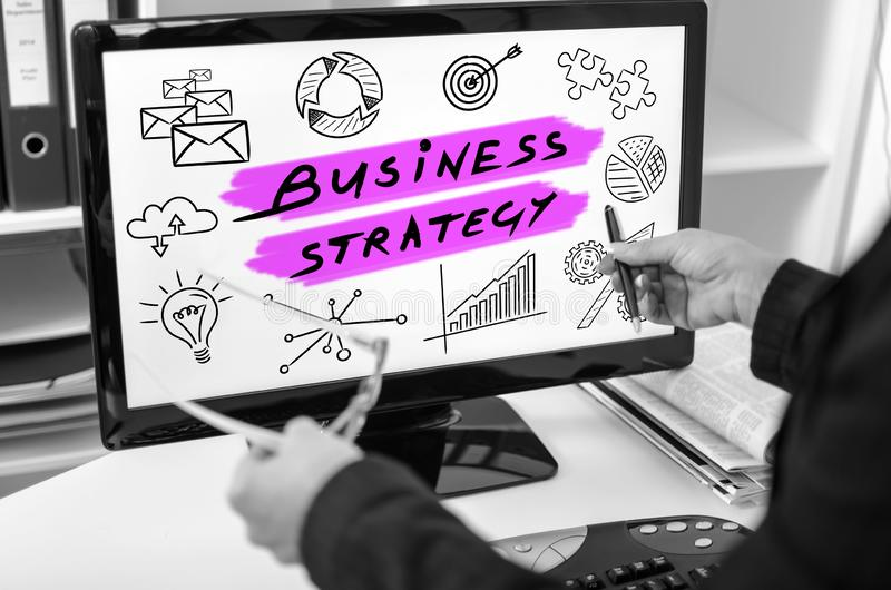 Business strategy concept on a computer monitor. Businesswoman showing business strategy concept on a computer screen royalty free stock photography