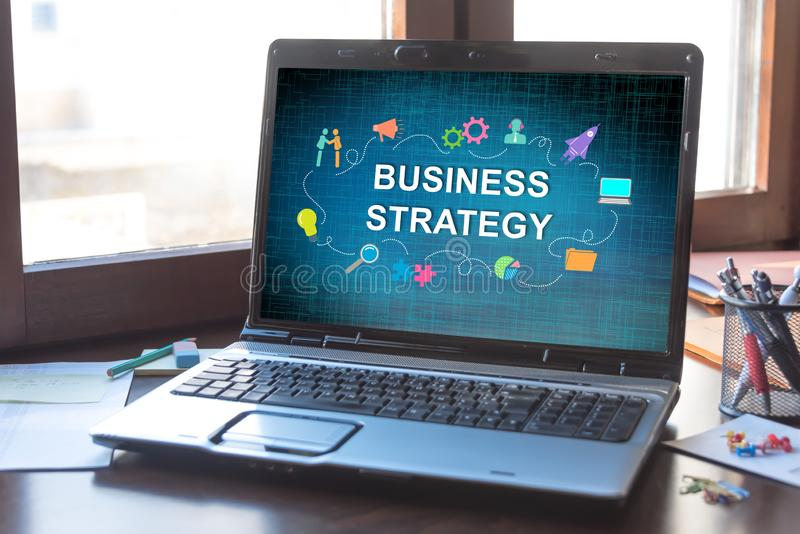 Business strategy concept on a laptop screen. Laptop screen displaying a business strategy concept stock images