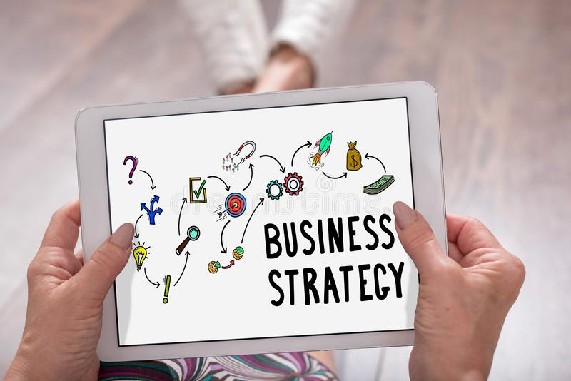 Business strategy concept on a tablet. Business strategy concept shown on a tablet held by a woman royalty free stock photos