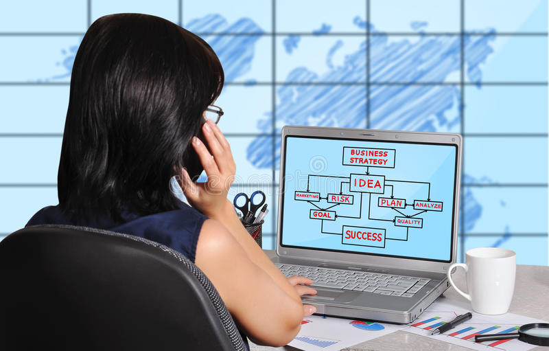 Business strategy concept. Woman and business strategy on screen laptop sitting in office stock images