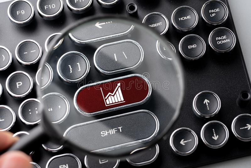 Business & strategy icon on computer keyboard in retro style. In studio royalty free stock photography