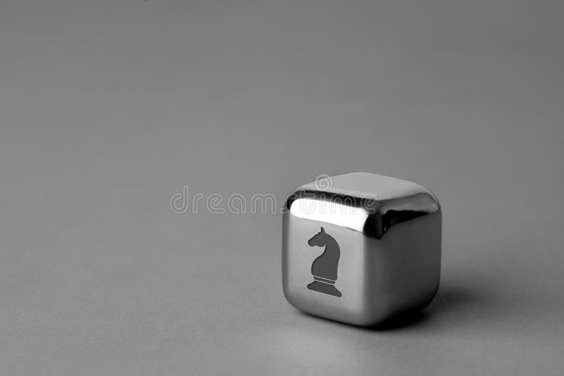 Business & strategy icon on metal cube for futuristic style. Lighting in studio stock photography