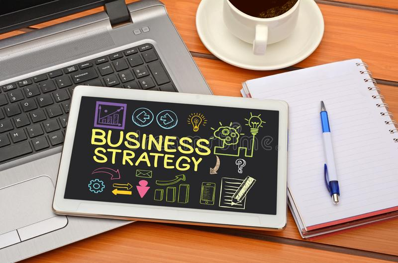 Business Strategy idea with icons in tablet laptop.  royalty free stock images