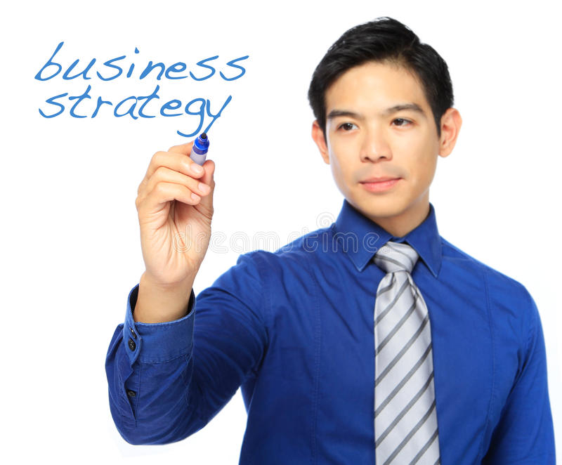 Business Strategy. A man writing on a business strategy royalty free stock images