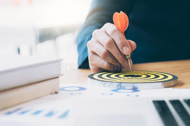 Business strategy planning success target goals. Businessman holding red dart push on target. Business strategy planning success target goals. Business royalty free stock photos